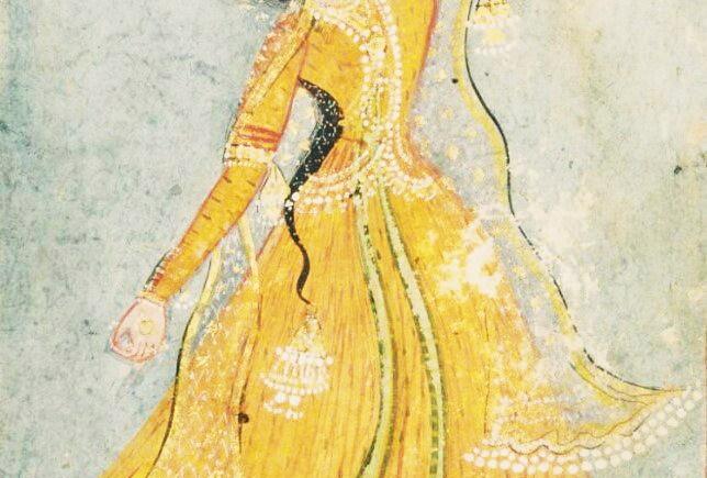 An Indian courtesan performing dance in yellow peshwaz.