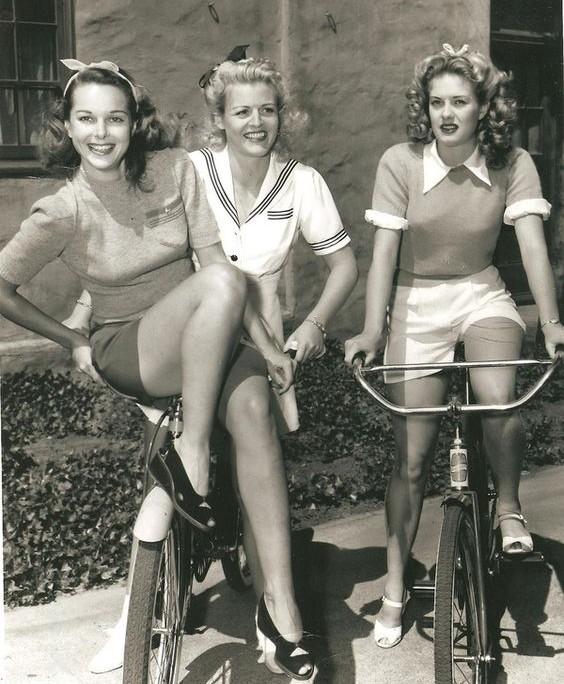 Trendy 1940's ladies on their bikes