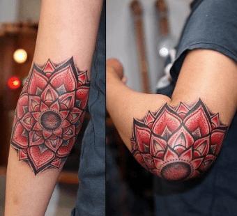 red-mandala-flowers-elbow-tattoos