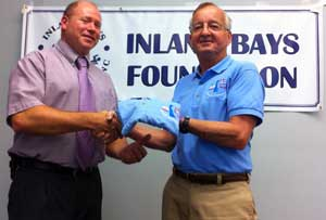 The Inland Bays Foundation President Bill Moyer is shown congratulating John Ashman - Sussex County Director of Utility Planning for briefing the Foundation Board on the Sussex County Public Sewer Initiative.