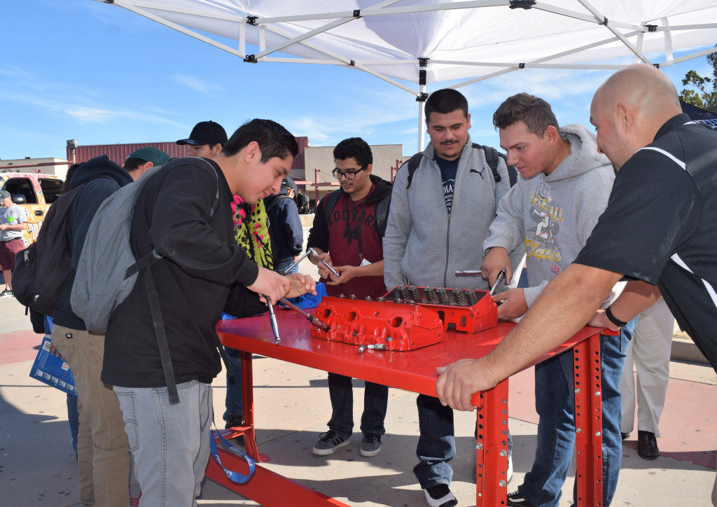 Students from A.B. Miller High in Fontana learn about auto tech careers