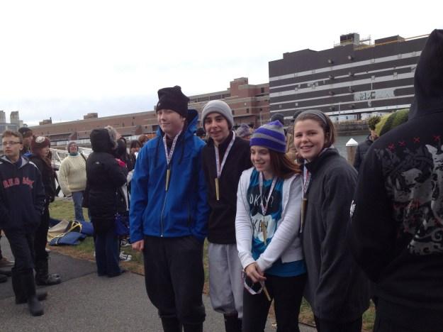 Team Inly, John McNeil, Charlie McDonald, Ali Faulkner, Caroline Leta, pose with their metals