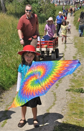 Youngster with a hat as bright as her kite, Bedwell Bayfront park, Menlo Park