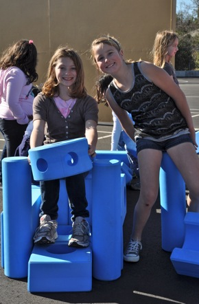 girls interacting with Imagination Playground at Oak Knoll School