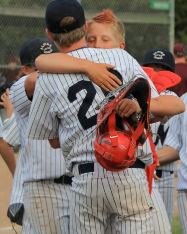 Morey's pitcher & catcher celebrate city championship victory