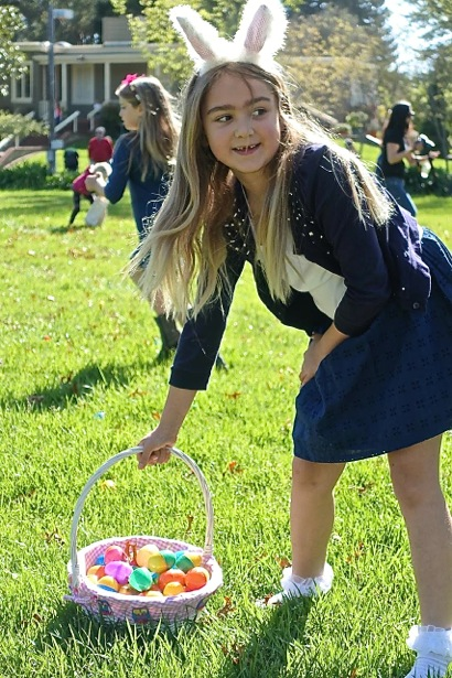 Girl egg hunting at Holbrook Palmer Park