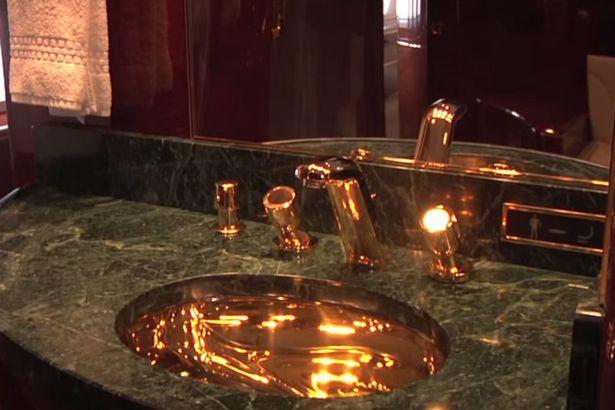 Gold bathroom fittings inside Trump's 757