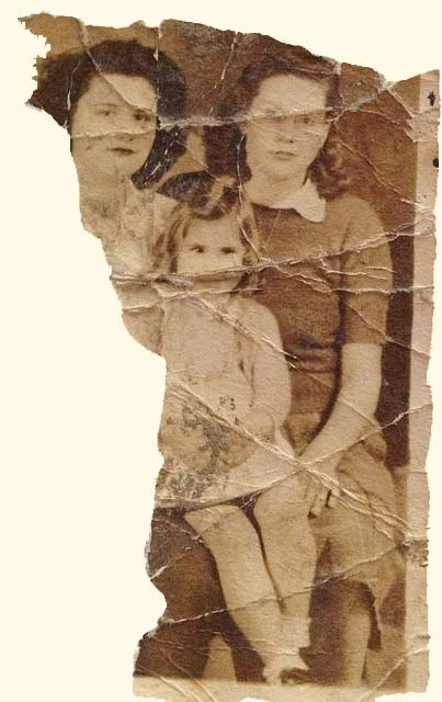 old torn family photo, symbolizing family constellation work