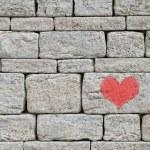 heart on stone wall
