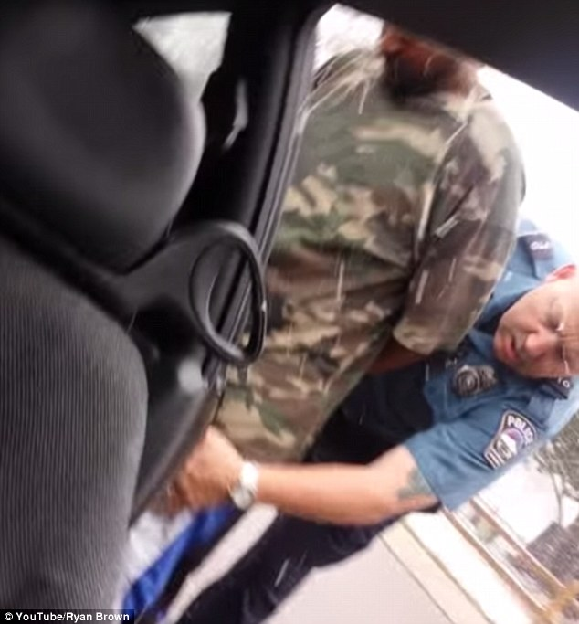Benjamin Brown (above), the driver, was handcuffed  before being patted down by Officer David Nelson