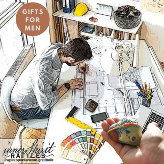 innerSpirit Rattles and an architect dad working at his desk