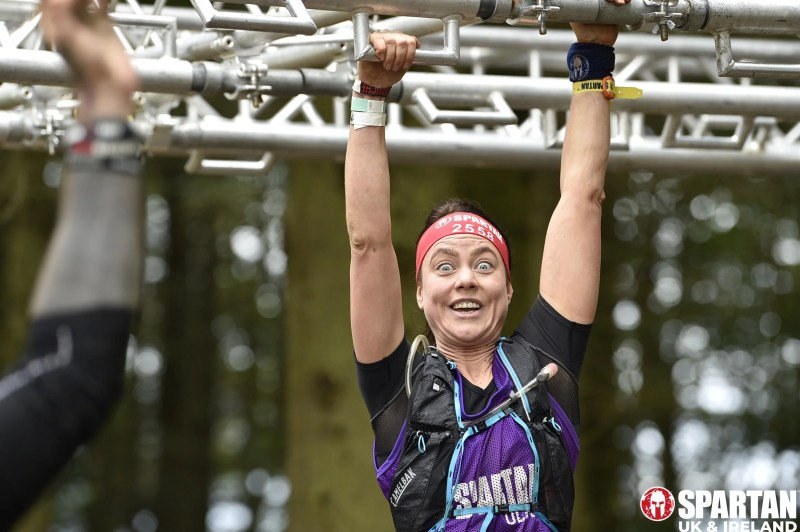 Andrea from Innes Reid Investments Limited tackles second obstacle in the Spartan Race.