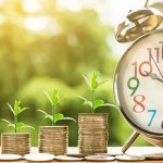 Tax Relief tips for 2020/2021 | Image showing money and alarm clock | Innes Reid Investments, Chester