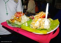 VIGORÓN: A traditional Nicaraguan dish that consists of a cabbage salad known as curtido (chopped cabbage, tomatoes, onions, and chili pepper marinated in vinegar and salt), boiled yuca, and chicharrones (fried pork with skin or with meat) wrapped in banana leaf. This dish is often eaten without silverware.