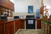 Kitchen is fully equipped with six burner gas stove, full size refrigerator, microwave, coffee maker, blender and toaster oven.