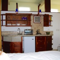 Kitchen is equipped with apartment sized refrigerator, two burner gas stove, toaster oven, coffee maker and blender.