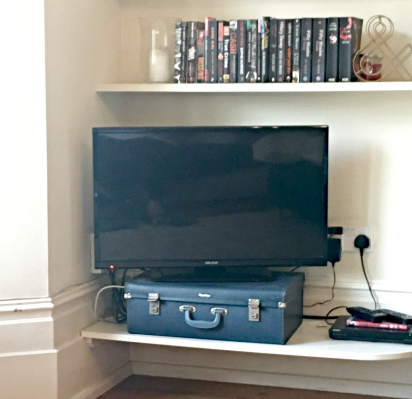 Vintage suitcase as a TV stand
