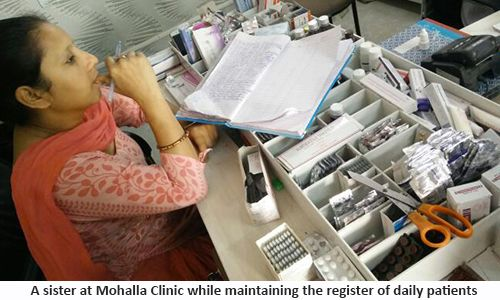 A sister at Mohalla Clinic while maintaining the register of daily patients