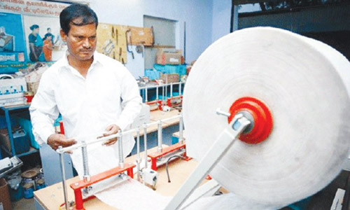 Arunachalam-working-on-machine