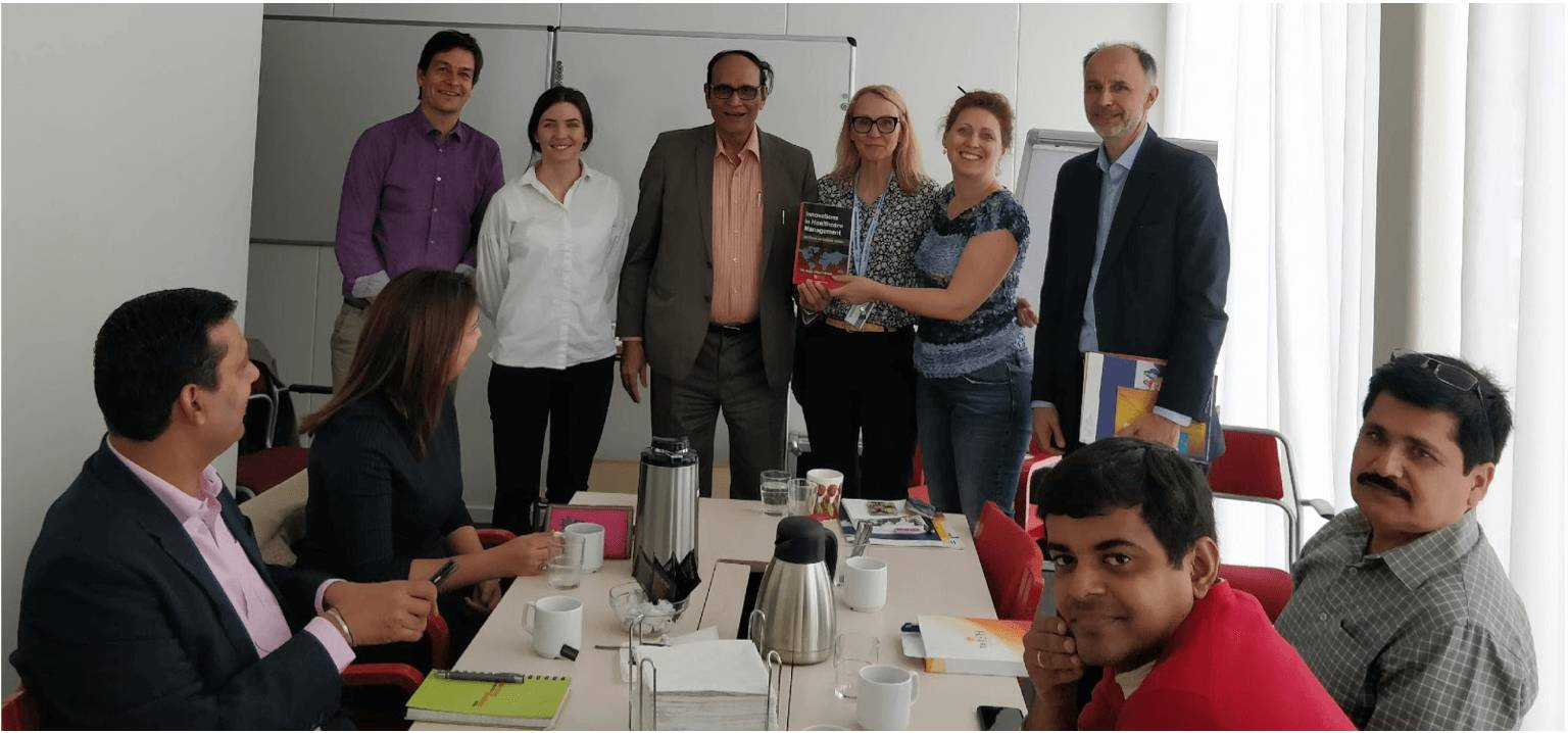 Figure 5 - Dr V K Singh from Indian delegation presented his healthcare innovation book to the chairman of Swecare board and Uppsala regional council, Ms Vivianne Macdisi