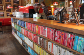 The Laudromat Cafe, with color organized books