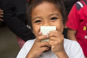 Clean the World - child smelling soap