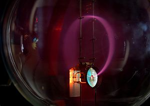 Beam of electrons moving in a circle in a magn...