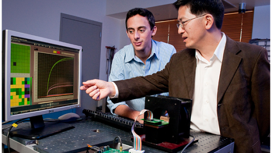 Stanford Professor Shan Wang and graduate student Richard Gaster, left, have developed an early-warning system for cancer (Images: L. A. Cicero)