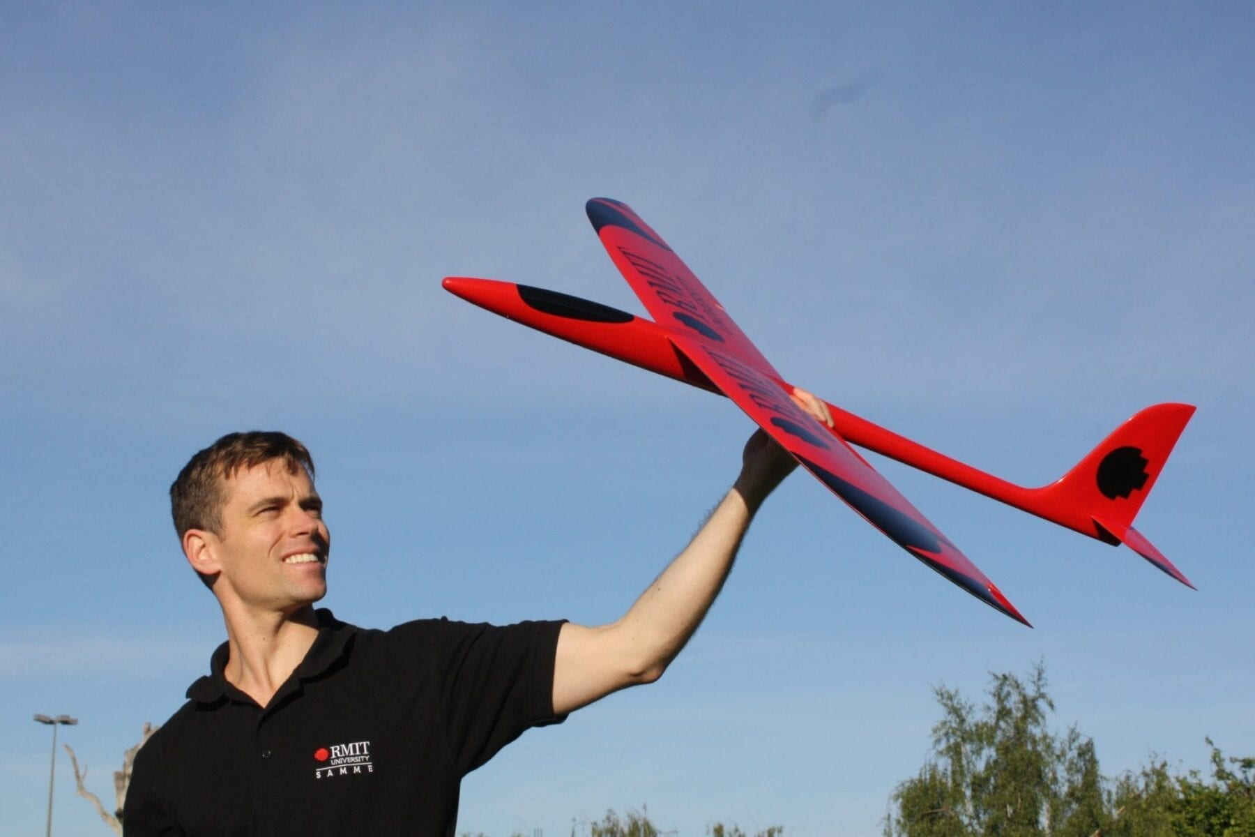 Dr Reece Clothier with a prototype of a bio-inspired unmanned aircraft, under development at RMIT University.