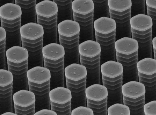 A scanning electron microscope image shows the rigid pillar-like bristles of the FLUENCE rake, which is used to apply light-harvesting polymers to a solar cell. The distance between the pillars is 1 micrometer, about one-hundredth the diameter of a human hair. (Z. Bao et al, Nature Communications)