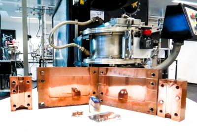 Shown are the castings of the bulk metallic glass (in front), the copper moulds and the induction furnace used to produce the material. CREDIT Dr. Kevin Laws, UNSW Australia