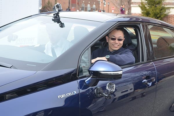 Yushan Yan, at the wheel of a fuel cell vehicle, is conducting research on the use of nickel as a catalyst in an alkaline electrolyte that promises to bring down the cost of hydrogen fuel cells.