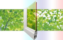 Inexpensive double-pane solar windows made with low-cost quantum dots