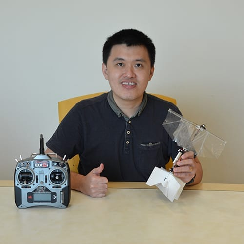 Dr Yao-Wei Chin with the flapping wing drone prototype