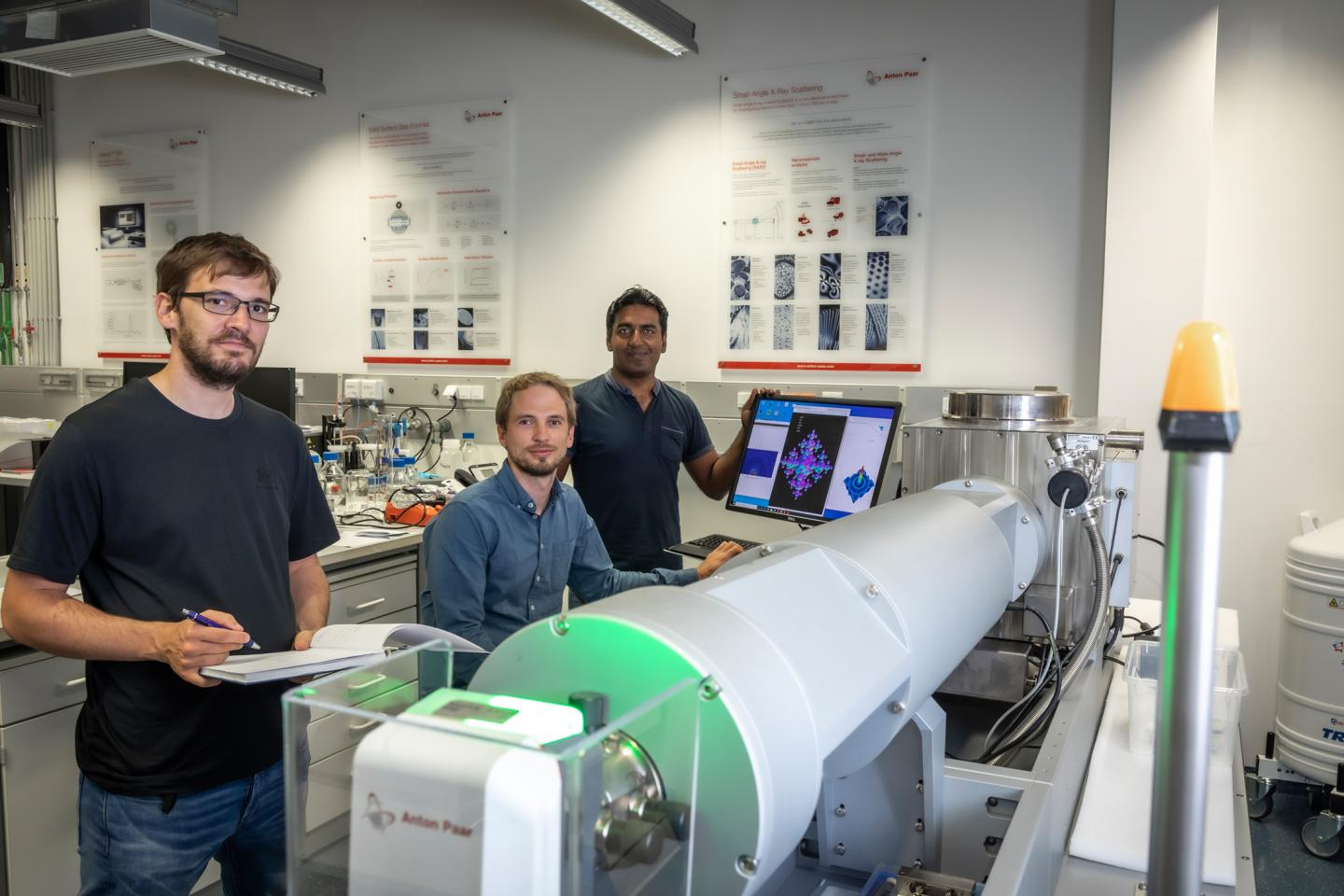 Harald Fitzek, Christian Prehal and Qamar Abbas (from left) at the SAXS facility SAXSpoint 2.0 (Anton Paar GmbH): With their work at Graz University of Technology, the researchers are providing new insights into hybrid supercapacitors.  CREDIT: Lunghammer - TU Graz