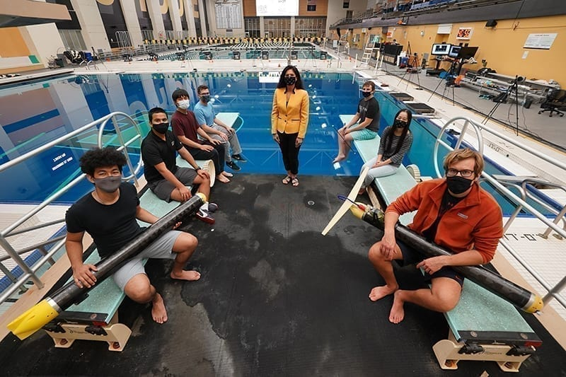 Nina Mahmoudian (center) and her students have developed an underwater glider that can operate silently in confined spaces, ideal for conducting biology or climate studies without disturbing wildlife. (Purdue University photo/Jared Pike)
