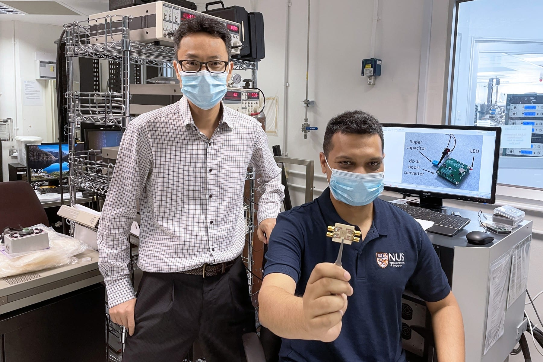 The research breakthrough was achieved by a team led by Professor Yang Hyunsoo (left). Dr Raghav Sharma (right), the first author of the paper, is holding a chip embedded with about 50 spin-torque oscillators.