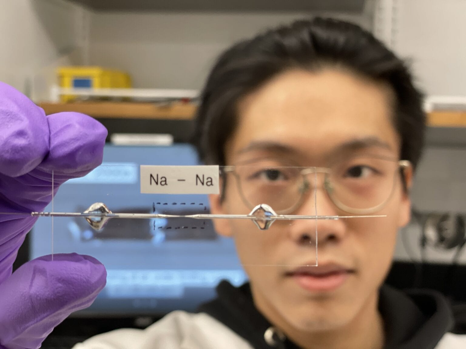 Bingyuan Ma holding a transparent capillary cell. Bai's Lab at the McKelvey School of Engineering is the only one in the world with such diagnostic cells. (Courtesy: Bai Lab)