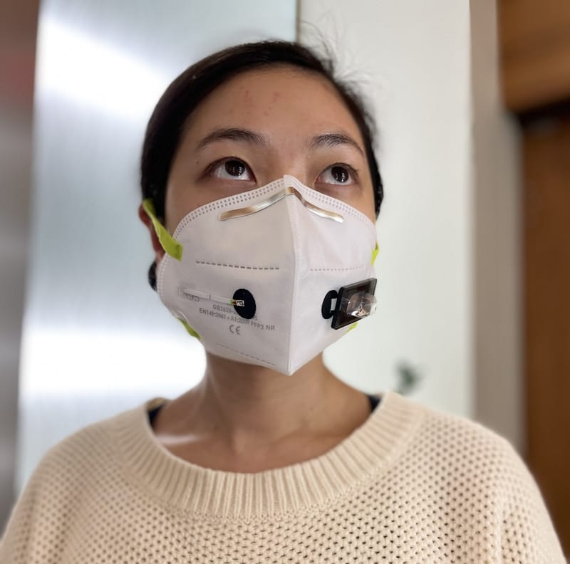 The wFDCF face mask can be integrated into any standard face mask. The wearer pushes a button on the mask that releases a small amount of water into the system, which provides results within 90 minutes. Credit: Wyss Institute at Harvard University