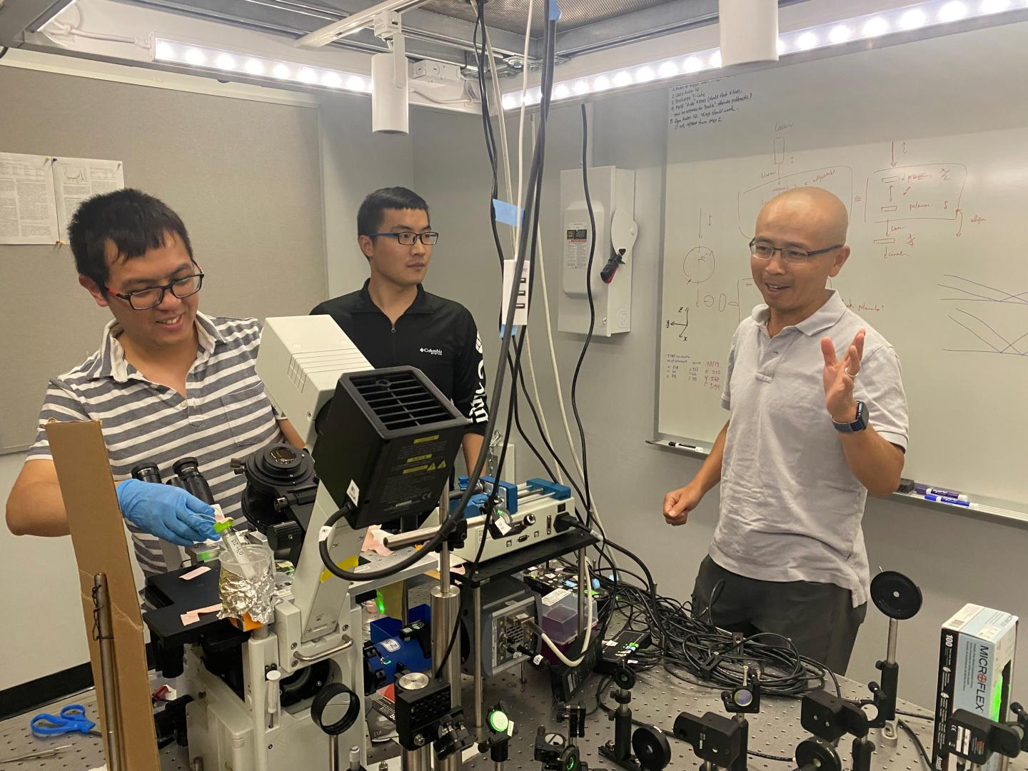Dr. Rong Ye (left), Dr. Ming Zhao (center), and Dr. Peng Cheng (right) at Cornell discuss their Army-funded research that identifies a new chemistry approach that could remove micropollutants from the environment.  CREDIT Cornell University