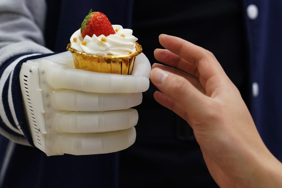 An MIT-developed inflatable robotic hand gives amputees real-time tactile control. The smart hand is soft and elastic, weighs about half a pound, and costs a fraction of comparable prosthetics. Courtesy of the researchers