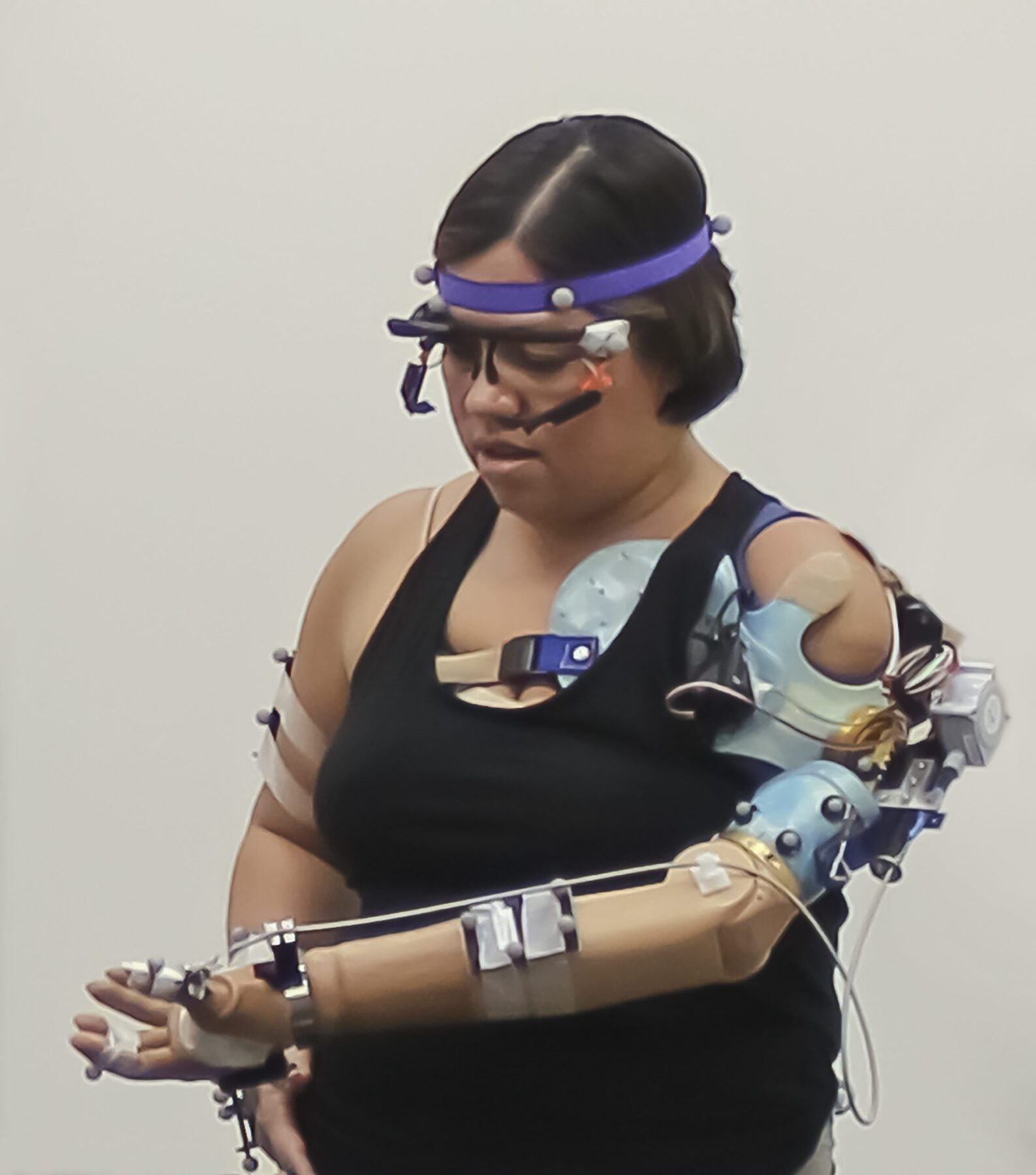 The advanced prosthetic arm feels grip movement sensation, touch on the fingertips, and is controlled intuitively by thinking. Reflective markers on users' arms and body help a computer see their movements in a 3D-environment, while glasses allow a computer to see exactly what they see.