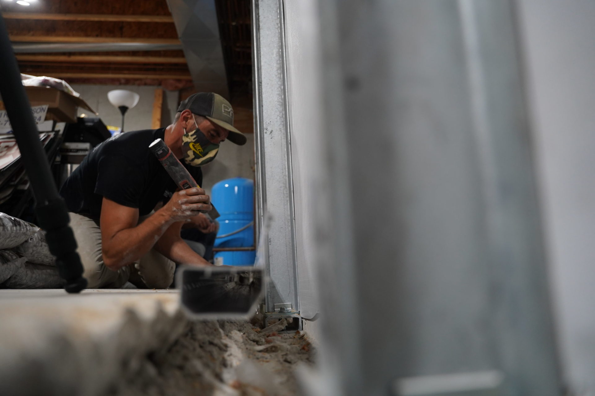 Side angle of crew installing basementGutter