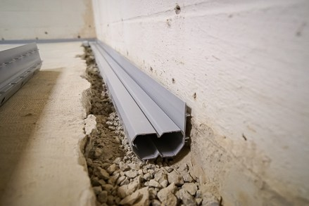 Installed basement gutter with french drain