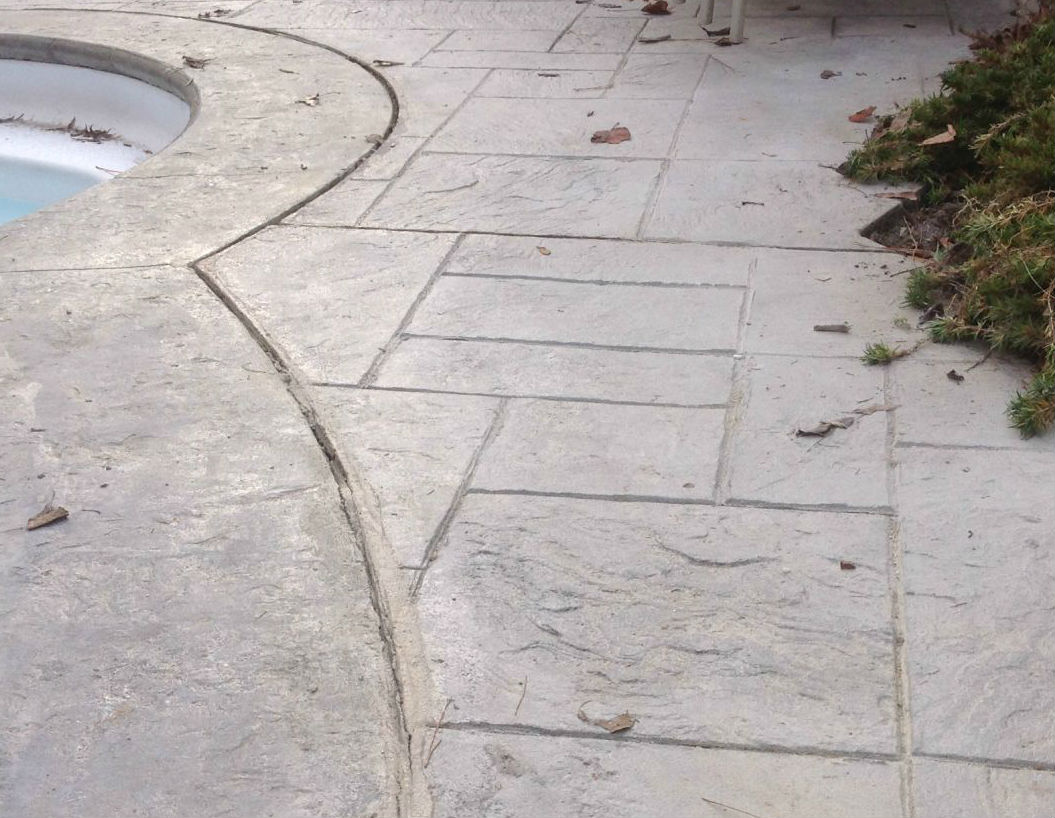 Sinking pool deck repaired with PolyRenewal® concrete lifting