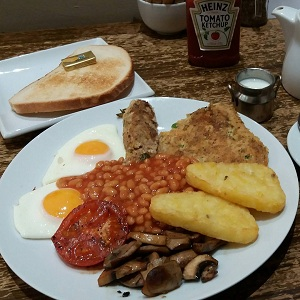 Full Welsh breakfast with laverbread pancake and glamorgan sausage
