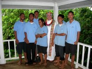 Yap Catholic High School students, wearing blue school uniform shirts, pose with Fr. Ciancimino.