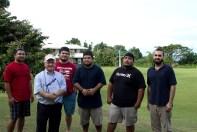 Fr. Richard McAuliff, SJ, director of Xavier High School (with clipboard), and Matthew Lopez, nSJ, (far right) supervise Xavier's cross-country team.
