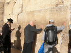 A close up shot of Fr. Keenan praying at the Western Wall. All are welcome but a yarmulke is required to cover one's head.