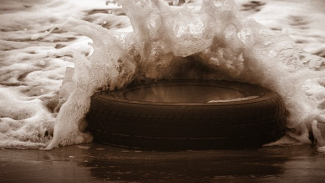 Waves crash on the tyre